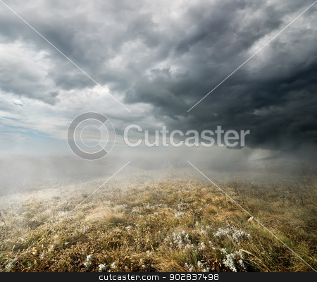 Clouds over the autumn field stock photo, Clouds and fog over the autumn field by Givaga