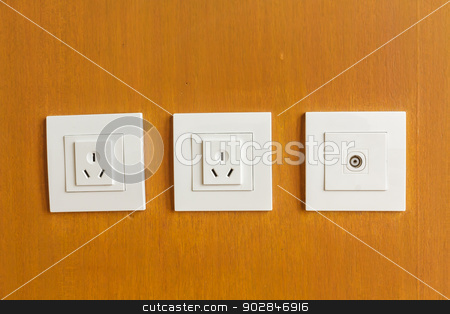 Electric plug at a wood wall stock photo, Electric plug at a wood wall in the room  by SONGSAK  AROMYIM