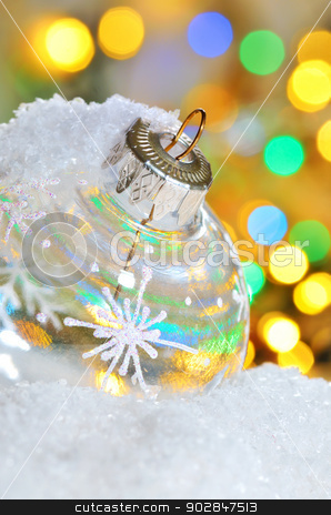 christmas ball stock photo, Transparent Christmas ball on snowy winter and yellow lights by Iordache Magdalena