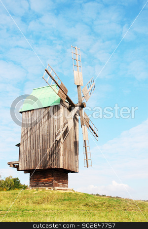 wind mill stock photo, wind mill is located the rural view by Iuliia   Malivanchuk