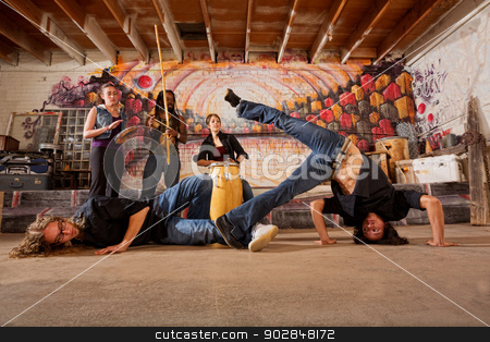 Brazilian Martial Artists Sparring stock photo, Two capoeira practitioners duel in urban building by Scott Griessel