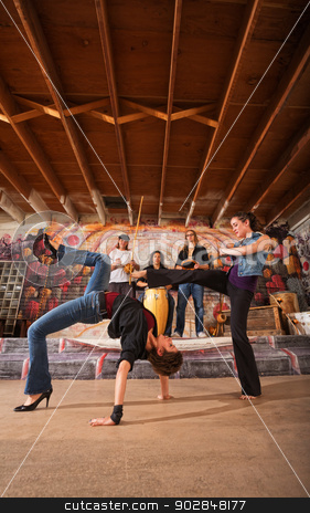 Female Capoeira Performers stock photo, Pair of female of capoeira performers sparring together by Scott Griessel