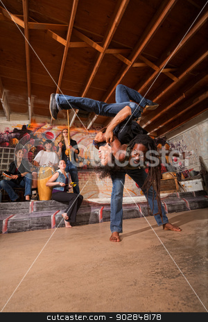 Capoeira Artists Flipping stock photo, Pair of capoeira performers throwing each other over their backs by Scott Griessel