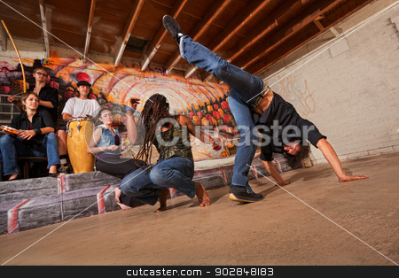 Capoeira Performers stock photo, Group of six capoeira performers in urban building by Scott Griessel