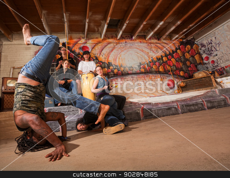 Acrobatic Capoeira Performers stock photo, Acrobatic group of capoeira performers in building by Scott Griessel