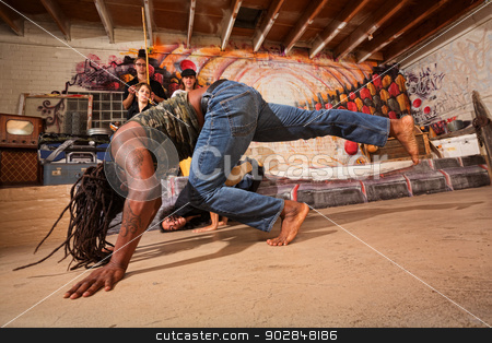 Pair of Capoeira Artists stock photo, Pair of male capoeira artists tumbling and kicking by Scott Griessel