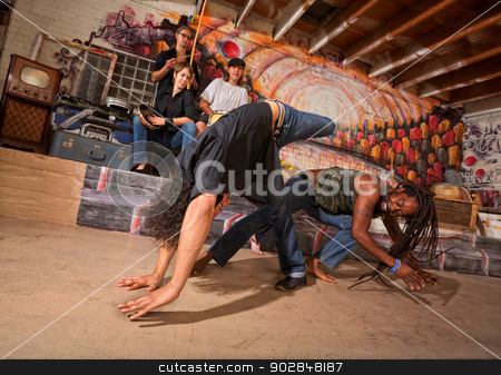 Capoeira Performers Tumbling stock photo, Brazillian capoeira martial artists tumbling and kicking by Scott Griessel