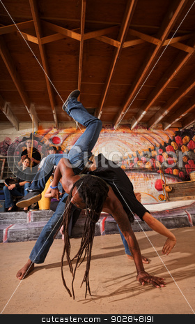 Capoeira Performers Working Out stock photo, Capoeira partners working out with musicians indoors by Scott Griessel