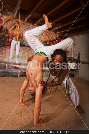 Helping Capoeira Partner with Handstand stock photo, Capoeira expert working with partner in handstand by Scott Griessel