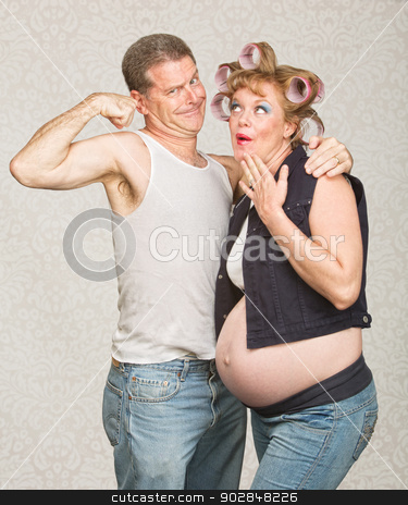 Man Showing Biceps to Pregnant Woman stock photo, Amazed pregnant hillbilly woman and man flexing biceps by Scott Griessel
