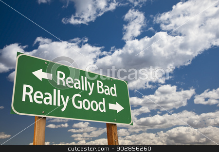 Really Bad, Really Good Green Road Sign and Clouds stock photo, Really Bad, Really Good Green Road Sign with Dramatic Clouds and Sky. by Andy Dean