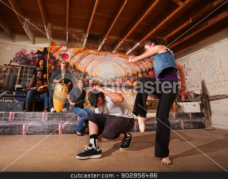 Musicians and Capoeira Performers stock photo, Musicians playing during a capoeira performance indoors by Scott Griessel
