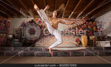 Capoeira Flying Kick stock photo, Handsome capoeira performers demonstrating a flying kick by Scott Griessel