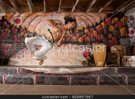 Handsome Capoeira Man Flipping stock photo, Handsome mixed capoeira performer flipping mid air by Scott Griessel