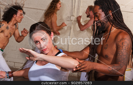 Capoeira Instructor Helping Student stock photo, Young capoeira student with handsome instructor by Scott Griessel