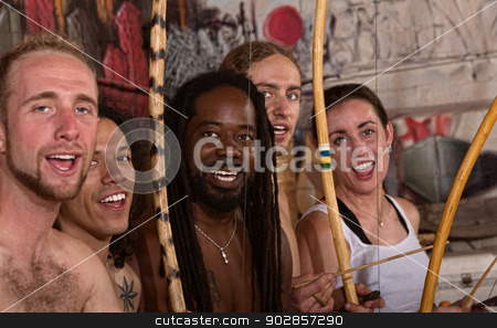 Singing Capoeira Performers stock photo, Group of capoeira martial artists singing together by Scott Griessel