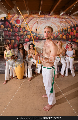 European Capoeira Musician stock photo, European capoeira performers with group playing music indoors by Scott Griessel