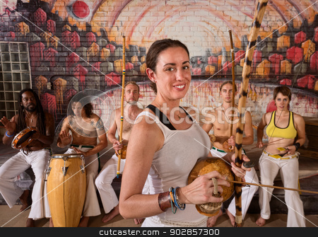 Happy Capoeira Musician stock photo, Young group of capoeira musicians in urban building by Scott Griessel