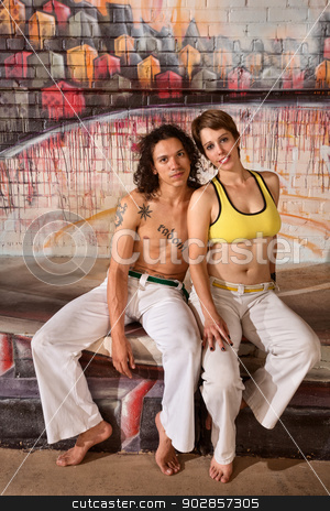 Cute Capoeira Couple stock photo, Cute mixed couple in capoeira outfit indoors by Scott Griessel