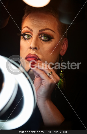 Drag Queen Using Lipstick stock photo, Serious Caucasian drag queen using lipstick by Scott Griessel