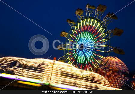 County Fair stock photo, Amusement Rides with Movement Blur in the evening at the Kentucky State Fair Midway Louisville Kentucky by David Davis