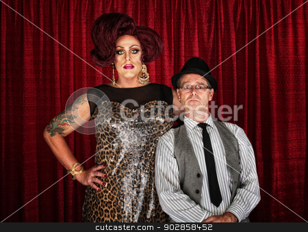 Drag Queen and Retro Man stock photo, Odd couple drag queen with man at curtain by Scott Griessel