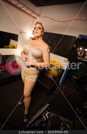 Man Dressing in Drag stock photo, Single man in foundation for drag queen outfit by Scott Griessel