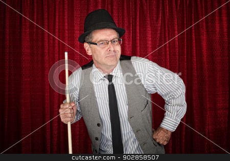 Pool Player with Attitude stock photo, Sneering man in pinstripe shirt and poolstick by Scott Griessel