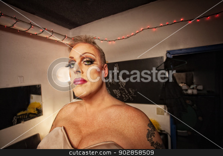 Drag Queen in Dressing Room stock photo, Serious drag queen with bra and tattoo in dressing room by Scott Griessel