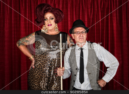 Skeptical Pool Player with Drag Queen stock photo, Skeptical pool player with big drag queen by curtain by Scott Griessel