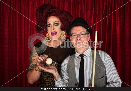Confident Pool Player with Queen stock photo, Confident pool player with cross dressing friend and cue ball by Scott Griessel