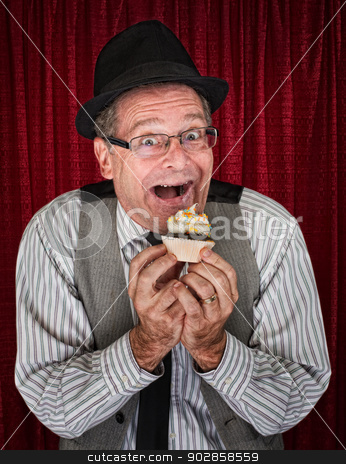 Happy Man with Cupcake stock photo, Happy retro style man holding a cupcake by Scott Griessel