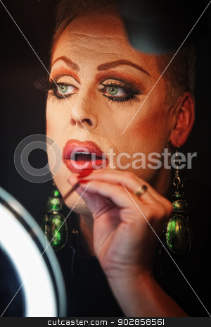 Man in Drag with Lipstick stock photo, Man in drag with lipstick and mirror by Scott Griessel