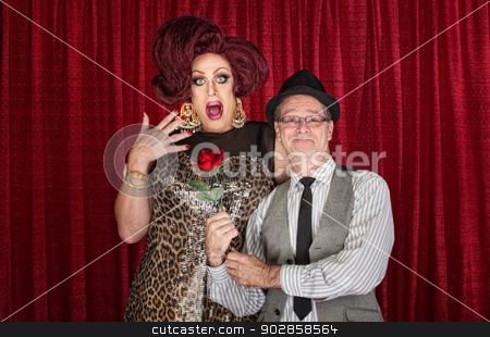 Man Gives Drag Queen a Rose stock photo, Retro man giving surprised drag queen a rose by Scott Griessel
