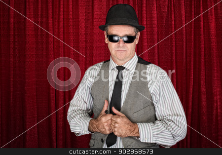 1960s Man with Sunglasses stock photo, 1960s style man in pinstripe shirt on curtain background by Scott Griessel