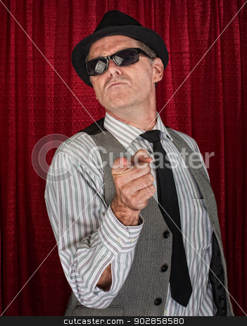 Retro Man Pointing stock photo, Cool retro style man in pinstripe shirt pointing by Scott Griessel