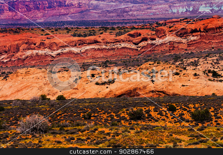 Painted Desert Yellow Grass Lands Orange Sandstone Red Moab Faul stock photo, Painted Desert Colorful Yellow Grass Lands Orange Sandstone Red Moab Fault Windows Section Arches National Park Moab Utah USA Southwest.  by William Perry