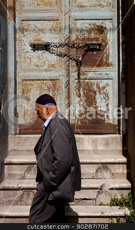 Muslim man passing Istanbul doorway stock photo, ISTANBUL, TURKEY – APRIL 28: Muslim man passing by doorway prior to ANZAC day on April 28, 2012 in Ankara, Turkey.  Each year patriotic Turks honor those fallen at the battle of Galipoli during World War I. by Scott Griessel
