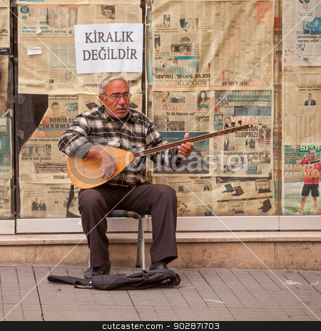 Turkish Street Musician stock photo, ISTANBUL, TURKEY – APRIL 28: Street musician performing on an oud prior to ANZAC day on April 28, 2012 in Ankara, Turkey.  Each year patriotic Turks honor those fallen at the battle of Galipoli during World War I. by Scott Griessel