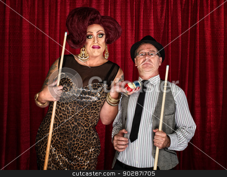 Surprised Pool Player with Drag Queen stock photo, Drag queen holding pool balls with surprised man by Scott Griessel