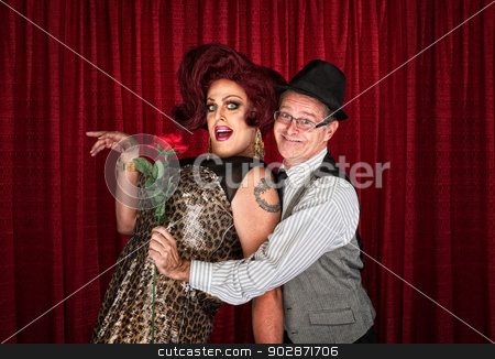 Man Holding Drag Queen stock photo, Man in hat attracted to drag queen by Scott Griessel