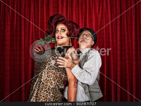 Dramatic Drag Queen with Man stock photo, Dramatic drag queen in theater with man in pinstripe shirt by Scott Griessel
