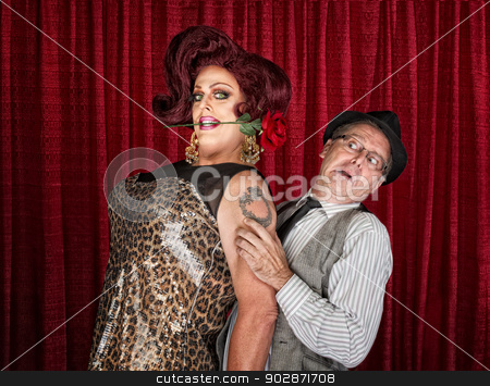 Tall Drag Queen with Friend stock photo, Tall drag queen with rose in mouth and friend by Scott Griessel
