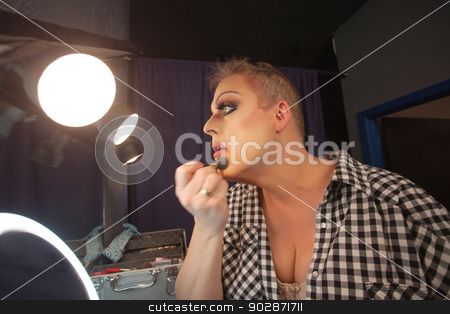 Man Preparing for Drag Queen Show stock photo, Man in dressing room preparing face for drag queen show by Scott Griessel