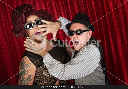 Surprised Famous Couple stock photo, Surprised drag queen and partner in sunglasses by Scott Griessel
