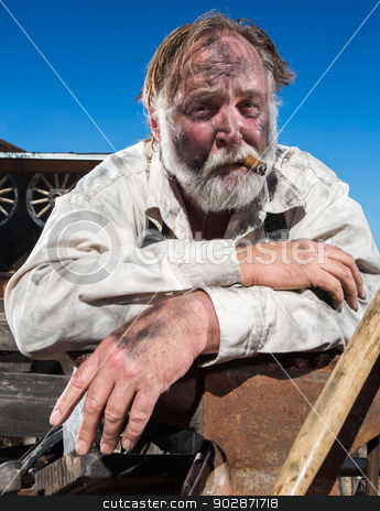 Old West Blacksmith stock photo, Old West Blacksmith Smokes a Cigar by Scott Griessel