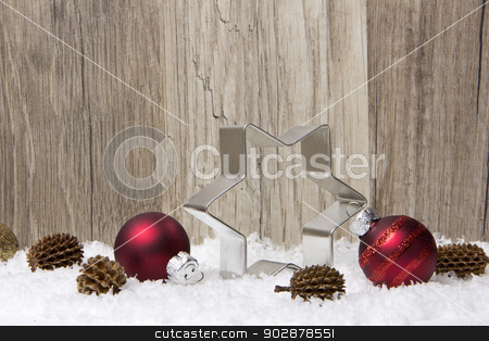 christmas decoration stock photo, christmas decoration with wooden background, snow, christmas baubles red, poinsettia, and pine cones  by Tomjac1980