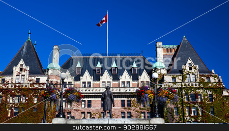 Historic Empress Hotel Victoria British Columbia Canada stock photo, Historic Empress Hotel Inner Harbor British Columbia Canada.  Built between 1904 and 1905, one of the oldest and most famous hotels in Canada.  National Historic Site in Canada. Captain Cook Statue. by William Perry