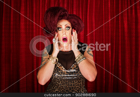 Amazed Man in Drag stock photo, Amazed drag queen with tattoos in theater by Scott Griessel