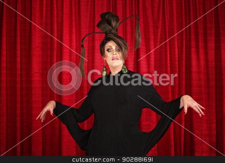 Eccentric Drag Queen stock photo, Drag queen in theater wearing unique dress by Scott Griessel